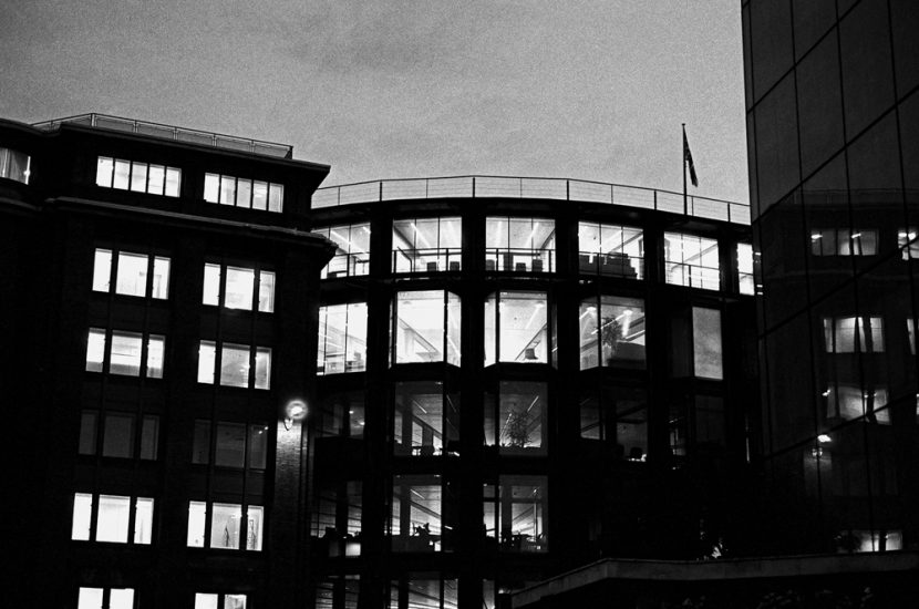Empyt offices with lights on at night time