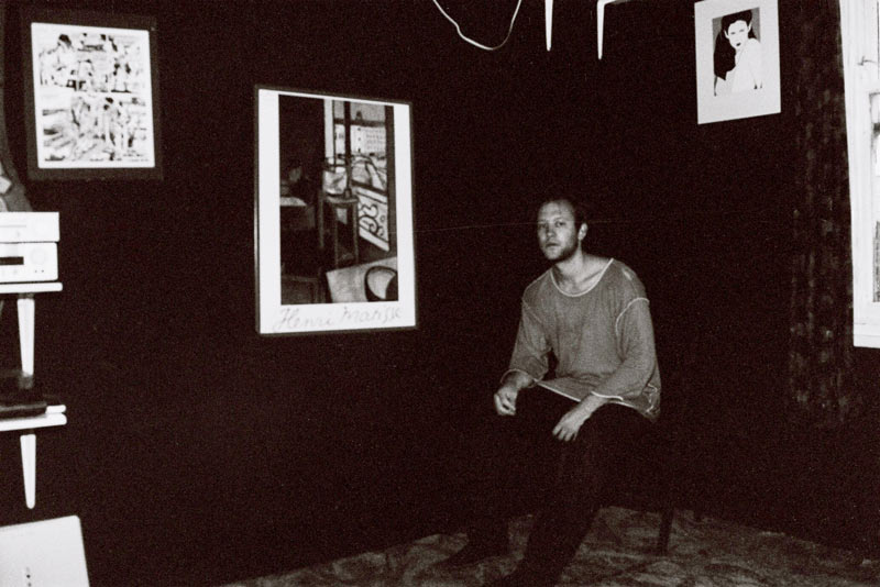 Young man sitting in a room